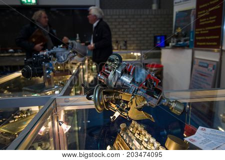 MAASTRICHT NETHERLANDS - JANUARY 09 2015: Stand of the firm for the sale of spare parts for oldtimers. In the foreground is the distributor of ignition. International Exhibition InterClassics & Topmobiel 2015