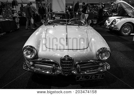 MAASTRICHT NETHERLANDS - JANUARY 09 2015: Compact car Alfa Romeo Giulietta Spider bodywork by Pininfarina. Black and white. International Exhibition InterClassics & Topmobiel 2015
