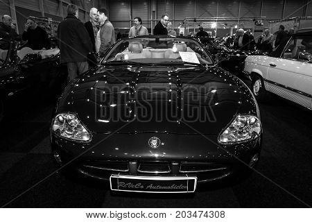 MAASTRICHT NETHERLANDS - JANUARY 09 2015: Grand tourer car Jaguar XK8 Convertible 2001. Black and white. International Exhibition InterClassics & Topmobiel 2015