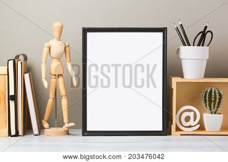 Modern workspace with blank frame mock up and office supplies. Creative desk interior background for socila media and marketing