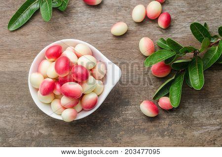 Bengal Currants Carandas-plum Carissa carandas in basket on the table.