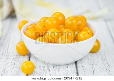 Wooden Table With Yellow Tomatoes, Selective Focus