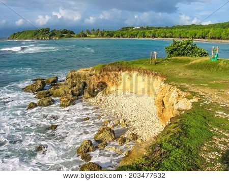 The spectacular sea cliffs of the coast of Grande Terre in Guadeloupe Island, Caribbean.