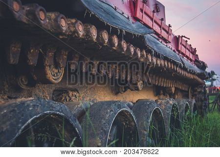 Old rusty all-terrain vehicle on tracks. bulldozer, dirt, industrial, land,