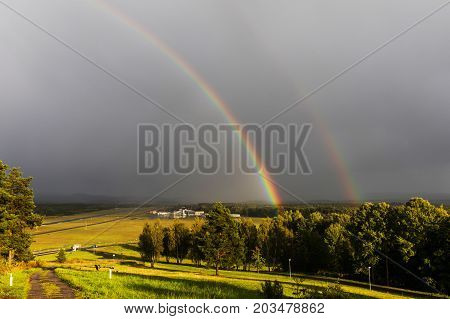 Karlovy Vary airport after storm under cloudy sky with double rainbow Karlovy Vary Czech republic