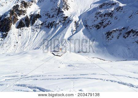 Alpine hut Potsdamer Hutte and mountain panorama with snow in winter in Stubai Alps Austria