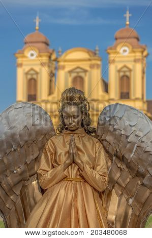 TIMISOARA ROMANIA - SEPTEMBER 8 2017: Living statue of a woman dressed with angel elements and present on the street inside the CheckART Carnival organized by the City Hall Timisoara. Union Square.