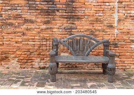 old chair wood with the brick wall