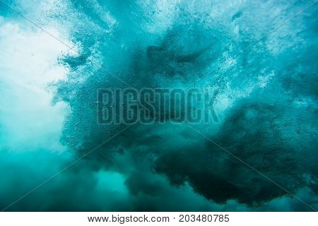 Wave underwater, water texture in blue ocean