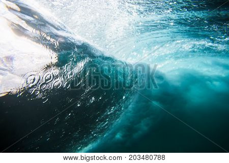 Barrel wave underwater. Blue ocean in Bali