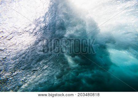 Wave underwater and sun light. Blue ocean in underwater