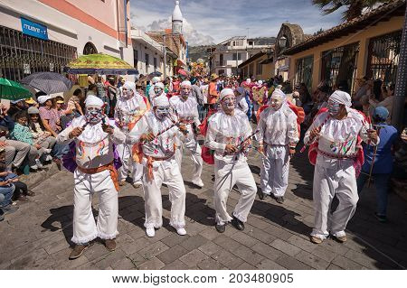 June 17 2017 Pujili Ecuador: men with painted face wearing costume at the Corpus Christi celebrations parade in the high altitude Andean town