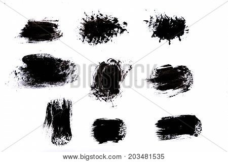 Strokes of black paint isolated on white background.