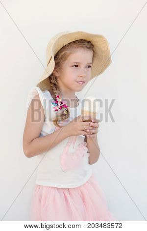 Portrait of a cute girl with ice cream on a walk. on a white background