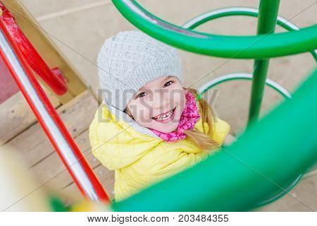 childhood leisure happy child having fun on the playground