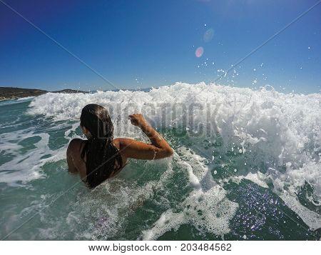 Girl Having Fun In Large Sea Waves