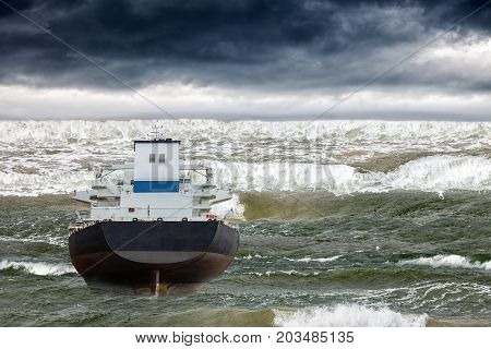 Tsunami disaster that threatens a ship on sea.