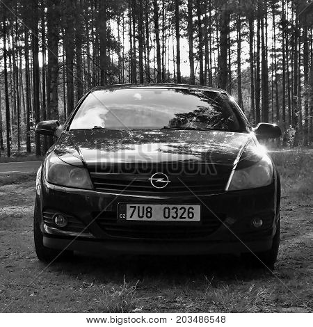 Stare Splavy, Czech Republic - August 12, 2017: Black Opel Astra H Stand On Grass Near Road Leading