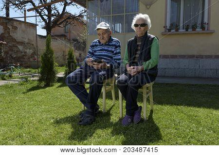 Grandparents Sitting Together Tablet Family Internet Garden