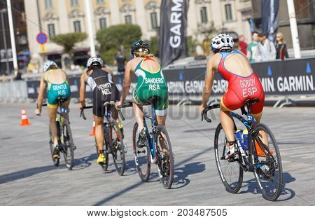 STOCKHOLM - AUG 26 2017: Rear view of group of female triathlete cyclists in the Women's ITU World Triathlon series event August 26 2017 in Stockholm Sweden
