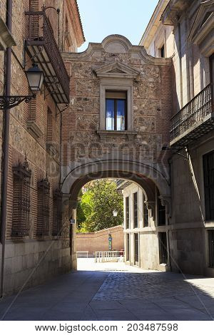 MADRID, SPAIN - MAY 24, 2017: This is an arched passage in the old town hall in the square de la Villa which was built in the 17th century.