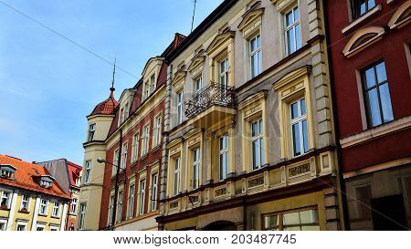 Historic tenement houses on the background of sky in the city center.
