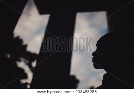 Preteen Boy On A Street In A Big City Next To A High-rise Building Alone.