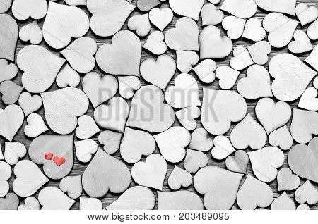 Wooden hearts small red hearts on the heart background. Valentine day.