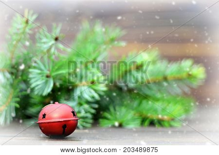 Christmas jingle bell and Christmas tree branches