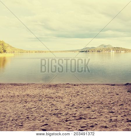 Sandy Beach By Macha's Lake With Bezdez Castle On Horizont At Sunset During Sommer Holidays In Czech