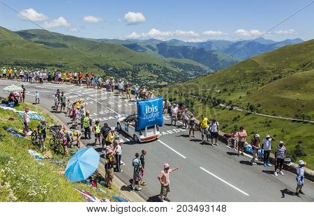 Col de PeyresourdeFrance- July 23 2014: Ibis Budget vehicle passing in the Publicity Caravn on the road to Col de Peyresourde in Pyrenees Mountains during the stage 17 of Le Tour de France 2014.