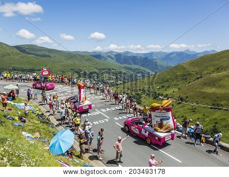 Col de PeyresourdeFrance- July 23 2014: St. Michel Madeleines vehicle passing in the Publicity Caravn on the road to Col de Peyresourde in Pyrenees Mountains during the stage 17 of Le Tour de France 2014.