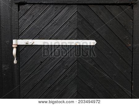 black wooden door with a white handle
