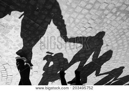 Urban scene of friendshipwith shadows in circle Naples