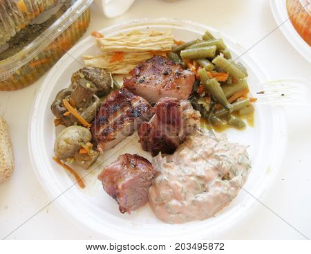 Shish Kebab In Disposable Dishes. Fried Meat In Plastic Plates.