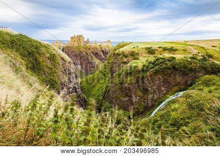 Scotland - August 2014: dunnottar castle at sunset scotland united kingdom It is located on a peninsula overlooking the North Sea