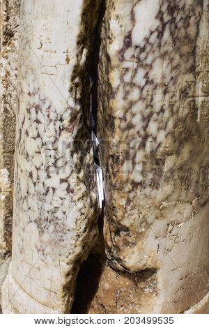 Cracked Marble Column at Entrance of Holy Sepulcher Cathedral in Jerusalem