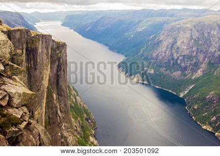 Aerial view of Lysefjorden from the mountain Kjerag, with waterfall on the cliff and mountains in background, in Forsand municipality in Rogaland county, Norway.