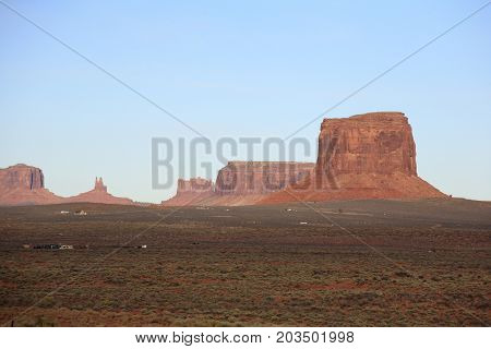 Monument Valley, a red-sand desert region on the Arizona-Utah border, is known for the towering sandstone buttes of Monument Valley Navajo Tribal Park.