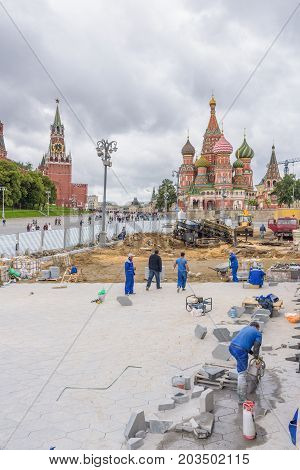 Moscow Russia - July 09 2017: Construction worker building street at St. Basil's Cathedral for prepare FIFA World Cup 2018 in Russia