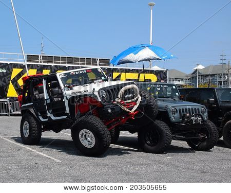 OCEAN CITY MD - AUGUST 26 2017: One Jeep Rubicon demonstrates a typical Jeep stunt on another Rubicon at Jeep Week in Ocean City Maryland.