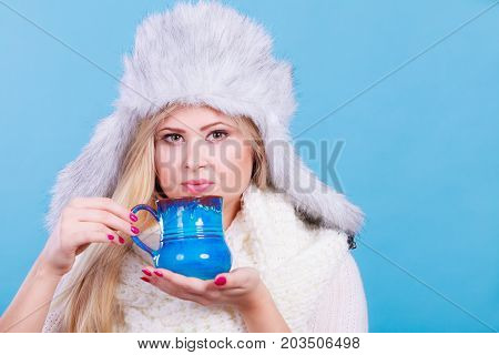 Blonde Woman In Winter Furry Hat Drinking