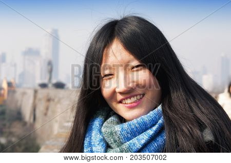 A smiling Chinese woman in Nanjing China.