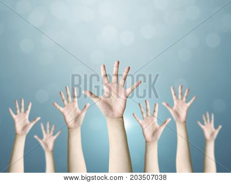 Group of hand raise up many people International volunteer day and community service concept