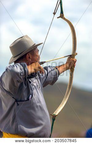 Naadam Festival Mongolian Man Archery Shooting Bow