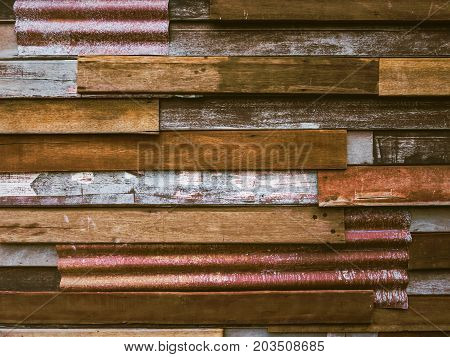 Old wood plank with galvanized iron background.