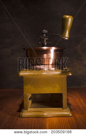 Wooden and rustic hand grinder without box for ground coffee