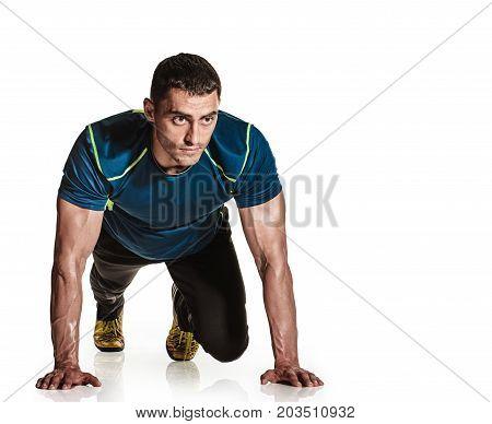 Strong sportsman doing push up training on white background