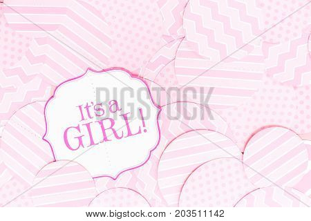 It's A Girl Sign At The Baby Shower Party.  Pink Patterns Background.  Baby Shower Celebration Conce