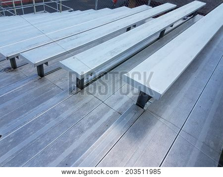 metal bleachers or sports seating at outdoor venue